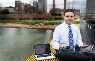 Owner of Huebris, Joshua Creed Gilmer poses at Railroad Park